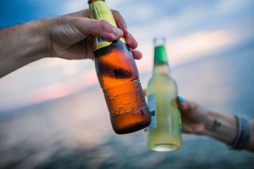 Cheers beach beer bottleman hand oppressing - David Hunter Law Firm