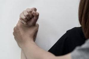 man hand oppressing - David Hunter Law Firm